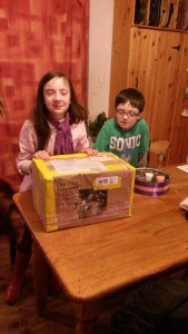 Elva and Eamonn with the box from Darragh in America